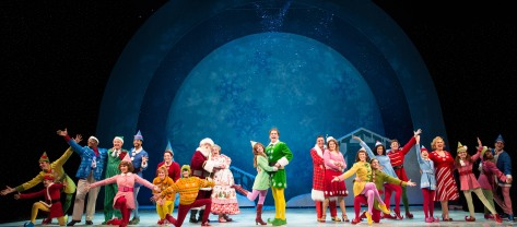 "Image of The cast of ""Elf"" (that's Michael Coale Grey far right in blue) at the Paper Mill Playhouse, Millburn, NJ./Photo Matthew Murphy."