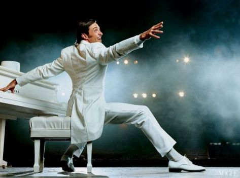 Image of actor Hugh Jackman in a white tuxedo as a piano in Best Actor in a Musical [winner]