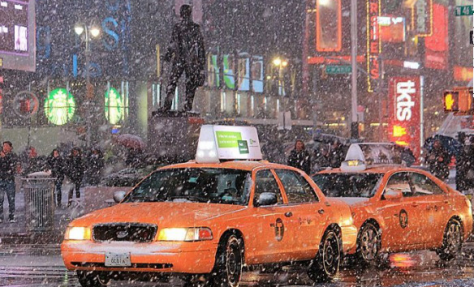 The biggest show in NYC tonight isn't a Broadway musical. Here, Times Square in a snow storm.