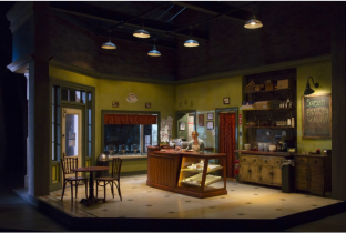 "Set designer Edward Pierce revolving stage — here the cafe — and lighting design by Jeff Croiter in Rachel Bonds' slice-of-life play ""Five Mile Lake."" (PHOTO: T. Charles Erikson)"