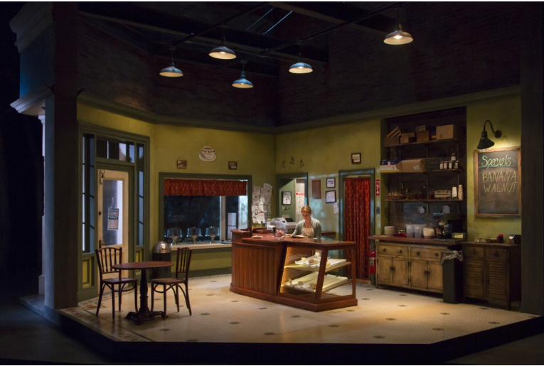 """Set designer Edward Pierce revolving stage — here the cafe — and lighting design by Jeff Croiter in Rachel Bonds' slice-of-life play """"Five Mile Lake."""" (PHOTO: T. Charles Erikson)"""