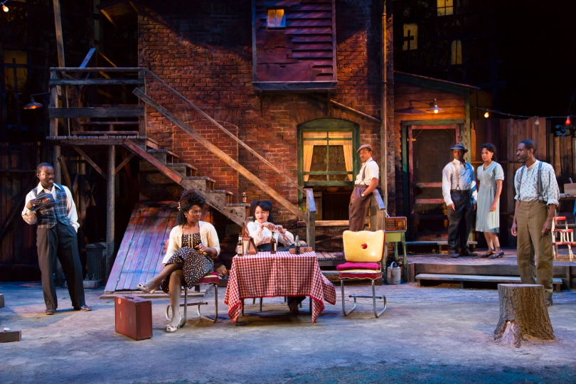 "The full company of August Wilson's ""Seven Guitars"" at Two River Theater. From left: Charlie Hudson III (Red Carter), Brittany Bellizeare (Ruby), Crystal A. Dickinson (Louise), Jason Dirden (Canewell), Kevin Mambo (Floyd Barton), Christina Acosta Robinson (Vera), and Brian D. Coats (Hedley). PHOTO: T Charles Erickson"
