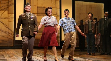 "Actors George Takei, Lea Salonga, and Telly Leung acknowledge the audience's cheers at the end of the final performance of ""Allegiance, a New American Musical"" at the Old Globe Theatre, the theater's most successful production. PHOTO: Charlie Neuman / UT San Diego"
