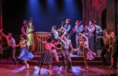 """The Bandstand"" at Paper Mill Playhouse stars Laura Osnes (at the microphone as Julia) Corey Cott (on the piano as Donny) and the company (PHOTO: Jerry Dalia)"