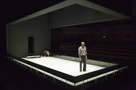 Set and lighting designer Jan Versweyveld designed a  rectangular set resembling a boxing ring with seats on  either side of the  stage.