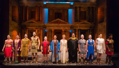 Christopher Fitzgerald (in red, fifth from left) as Pseudolus and the company of A Funny Thing Happened on the Way to the Forum at Two River Theater. (PHOTO: T. Charles Ericskson)