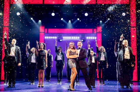 """The Bodyguard"" at Paper Mill Playhouse features Judson Mills as Frank Farmer hired to protect Deborah Cox (center) as pop singer Rachel Marron, who is being stalked . (PHOTO: Matthew Murphy)"
