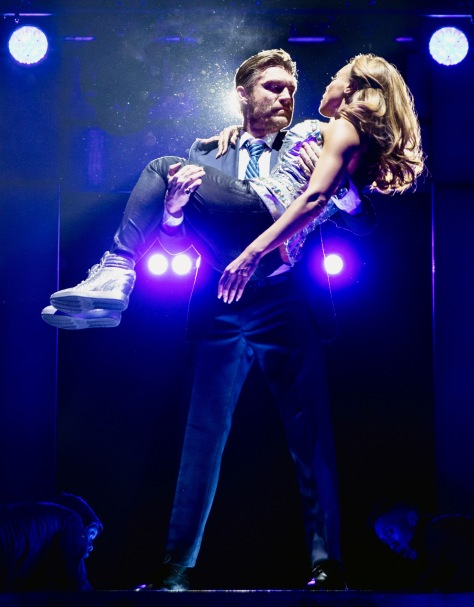"""""""The Bodyguard"""" at Paper Mill Playhouse features Judson Mills as Frank Farmer hired to protect Deborah Cox as pop singer Rachel Marron, who is being stalked . (PHOTO: Matthew Murphy)"""