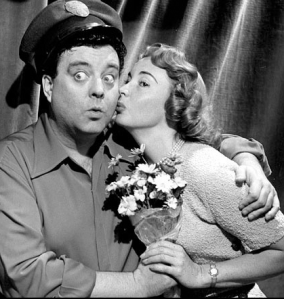 Publicity shot of Jackie Gleason as Ralph Kramden with Audrey Meadows as Alice, circa 1955