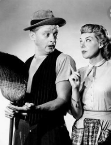 Art Carney as Ed Norton, a sewer worker, and his wife Trixie, played by Joyce Randolph